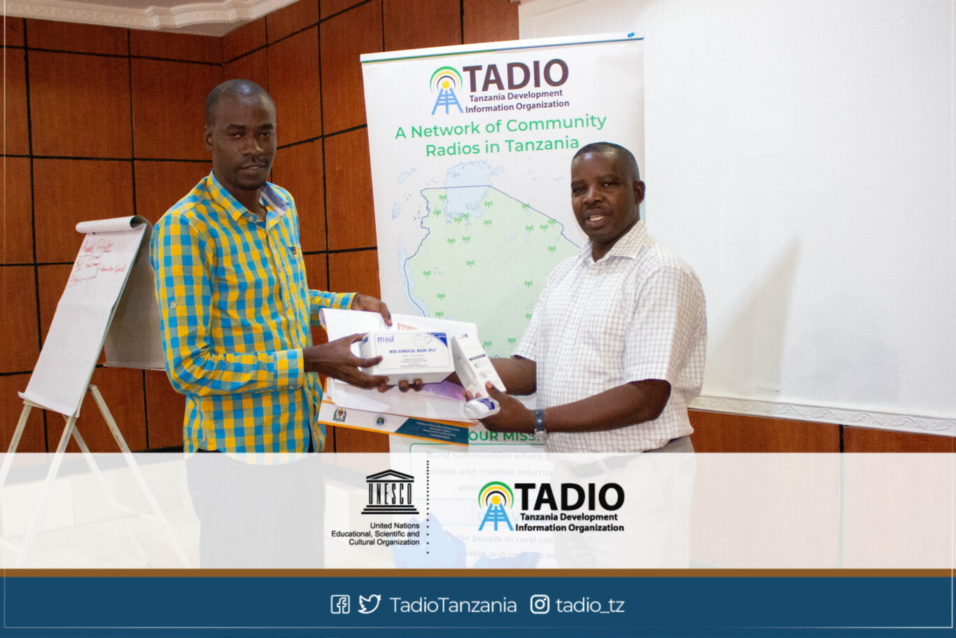 Mazingira FM Manager, Mr. Ally Nyamkinda receiving health protection equipment from TADIO Chairperson, Mr. Prosper Kwigize