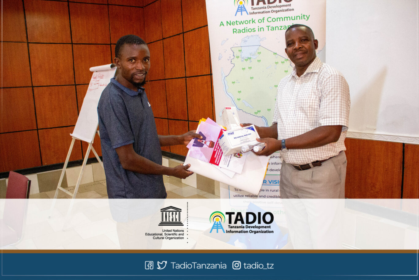 Ileje FM Manager, Mr. Maoni Mbuba receiving health protection equipment from TADIO Chairperson, Mr. Prosper Kwigize